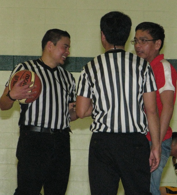 Referees share a light moment with PSA-Edmonton president Joey Doctolero.(Photo by Moses Billacura/pinoy edmonton news)