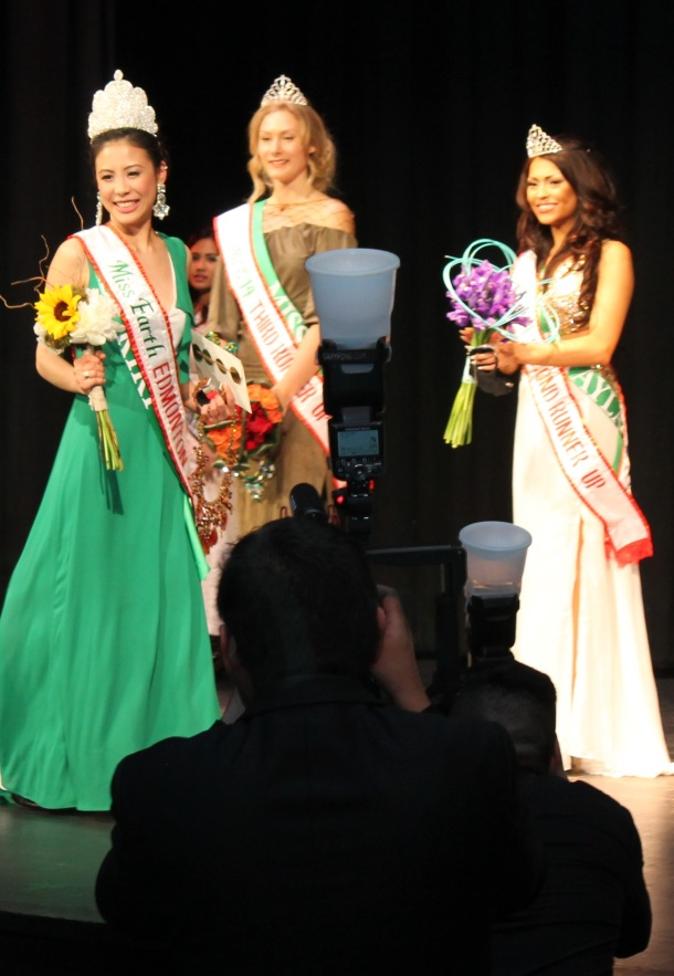 Photographers had their hands full as Kiki Szu-Yu Chen takes her first walk as newly-crowned Miss Earth Edmonton 2014, Saturday night, May 17, at the Royal Alberta Museum. Also shown are Miss Fire Edmonton 2014 Kyra Helene Wilchuk(center), who placed third runner-up, and Miss Water Edmonton 2014 Chayla Delorme Maracle, who emerged second runner-up. The tiaras were designed by pageant director Myrhalyn Dela Rosa.(Photo by Moses Billacura/pinoy edmonton news)