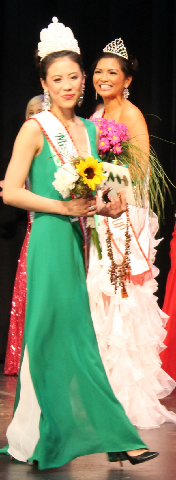 Kiki Szu-Yu Chen takes her first walk as newly-crowned Miss Earth Edmonton 2014, Saturday night, May 17, at the Royal Alberta Museum as first runner-up Jean Nicole de Jesus, who won the Miss Air Edmonton 2014 title, beams with a big smile. The tiaras were designed by pageant director Myrhalyn Dela Rosa.(Photo by Moses Billacura/pinoy edmonton news)
