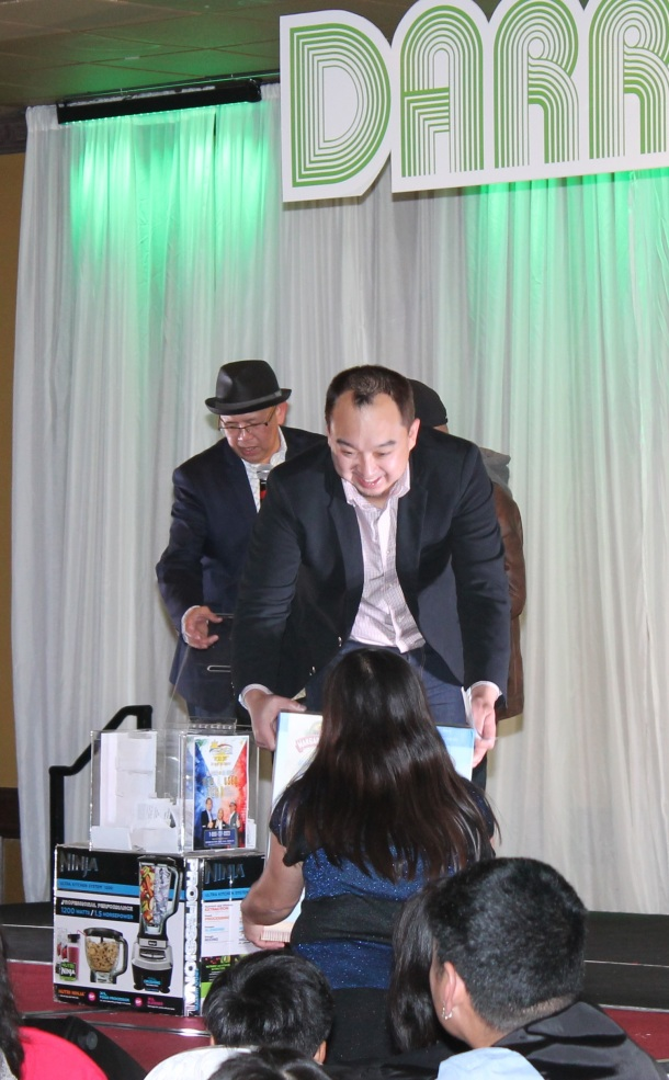 The Filipino Connection's Chester Tiongson awards one of the door prizes courtesy of Alberta's No.1 dealer Crosstown Auto Centre.(Moses Billacura/pinoy edmonton news)