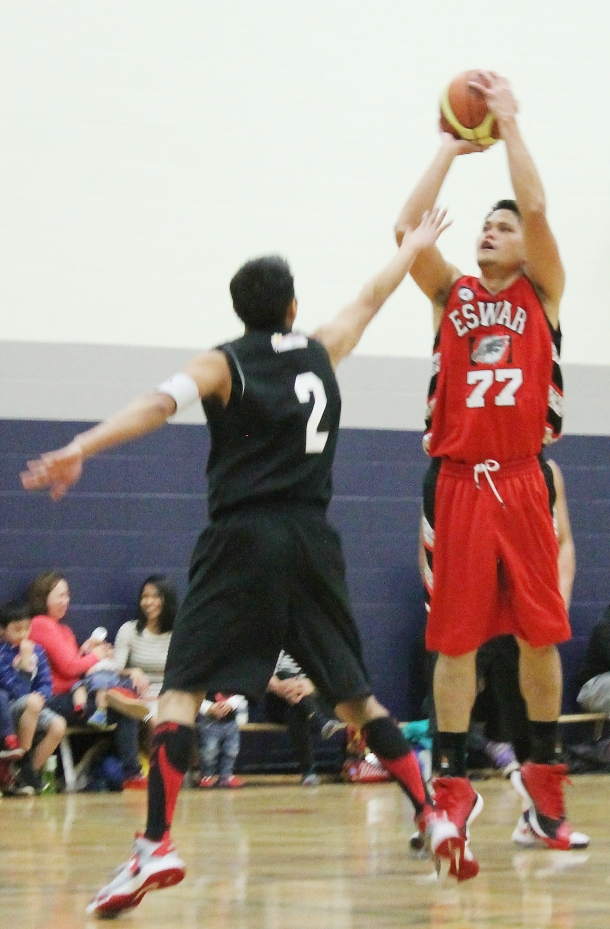 Eswar's Oliver Branzuela shoots over JR Sumaguit of Pish Payter in the 2015 Philippine Sport Association-Crosstown Auto Centre Spring League.(Photo by Moses Billacura/pinoy edmonton news)