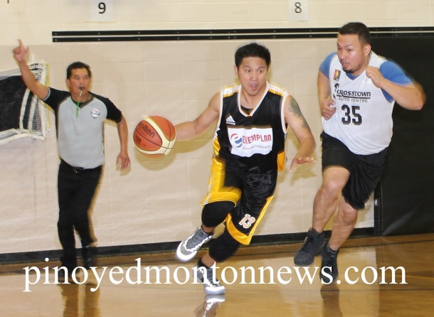 CT Warrior Paul Jumangit (No.35) chases Lowell Ferrer (No.13) of Exemplar Wealth Management in the 2015 Philippine Sport Association-Crosstown Auto Fall/Winter League, Sunday, at the Holy Trinity School gym. Exemplar Wealth won, 73-53.(Photo by Moses Billacura/pinoy edmonton news)