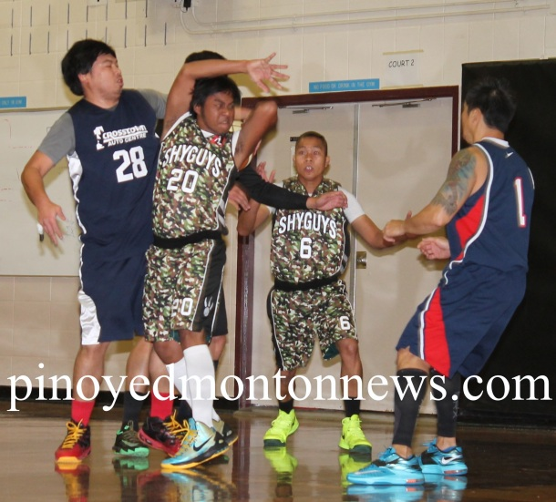 JOEL VS. JOEL.Shy Guys' Joel Batin (No.20) loses ball possession as Joel Olmo of R-Tax (No.28) grabs the ball from behind in this bit of action in the 2015 Philippine Sport Association-Crosstown Auto Fall/Winter League, Sunday, at the Holy Trinity School gym. R-Tax won, 78-66.(Photo by Moses Billacura/pinoy edmonton news)