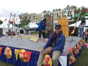 Journal publisher and Copaa president Jun Angeles is all smiles in yesterday's final set up of the Filipino Pavilion and stage where singers and dancers will peform.(Photo by Lito Velasco)
