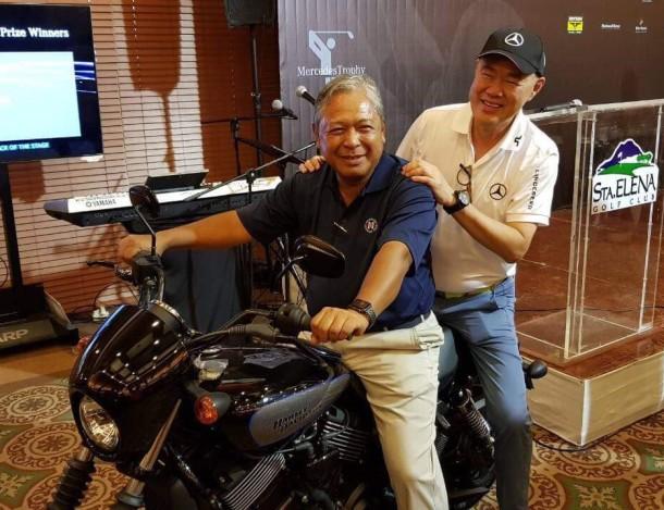 PAL golf JJB rides a Harley