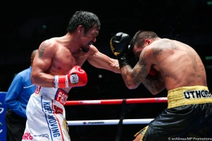 Manny Pacquiao knocked Lucas Matthysse at 2:43 of the seventh round and claimed his 11th world title, the WBA welterweight belt Sunday morning (Saturday night in the US) at the Axiata Arena in Kuala Lumpur, Malaysia.PHOTO CREDIT: WENDELL ALINEA